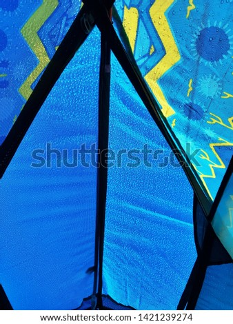 Top view of the tent with rain drops on it from inside - Structure of camping tent #1421239274