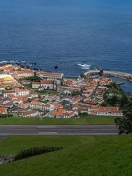 Top view of the village of de Santa Cruz das Flores with emphasis on the Church of Nossa Senhora da Conceição and Porto das Poças. In the foreground the airport runway. Flores Island.