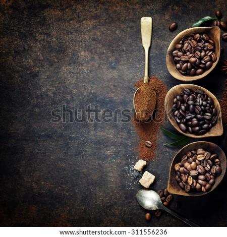 Top view of three different varieties of coffee beans on dark vintage background #311556236