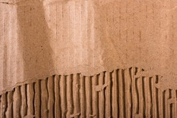 Top view of torn edges corrugated brown cardboard sheet of paper texture or background flat lay, Folded recycle carton paper box