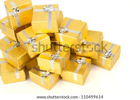 Top view of towel of gold gift boxes on white background