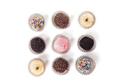 Top view of traditional brazilian sweets - brigadeiros - isolated over white background.