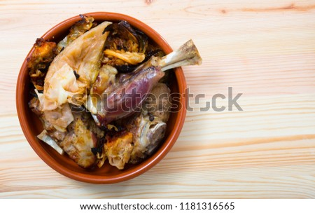 Top view of traditional Norwegian Farikal - stewed mutton on bone with cabbage and peppercorns served in clay dishware on wooden background #1181316565
