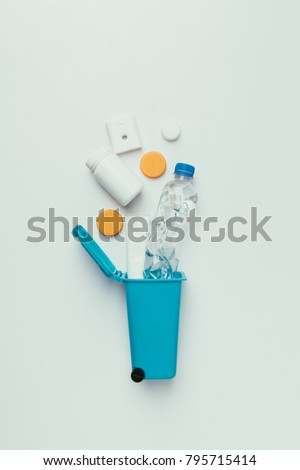 top view of trash bin with plastic garbage isolated on grey, recycling concept