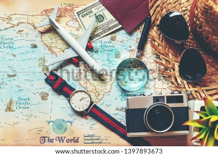 Top view of Traveler accessories and items man with tourism backpack and visiting for planning destination travel vacations on the world, copy space.  Travel and Summer holiday concept