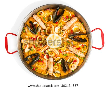 Top view of typical spanish seafood paella in traditional pan isolated on white background #303134567