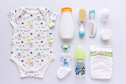 Top view of unisex  newborn baby necessities.