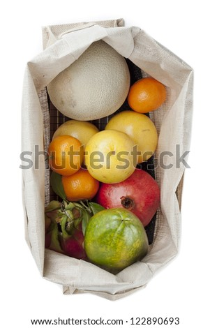 Top view of variety of fruits in sack over white background