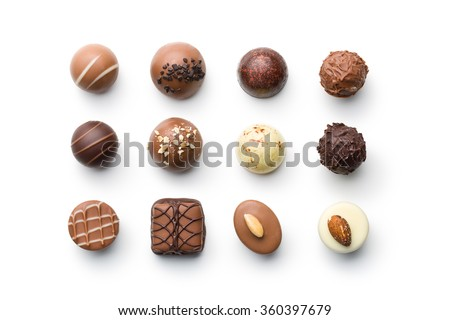 top view of various chocolate pralines isolated on white background
