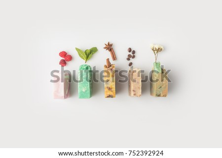 top view of various handcrafted soap with different ingredients in row on white surface #752392924