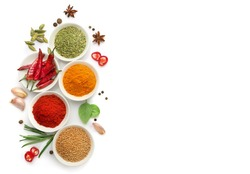 Top view of various spices in bowls isolated on white background. Copy space.