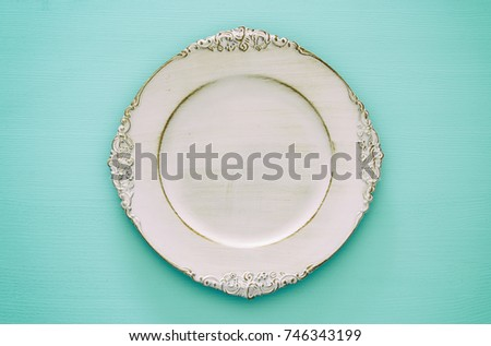 Top view of vintage white empty plate. Flat lay