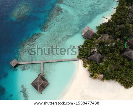 Top view of water bungalows and coral #1538477438