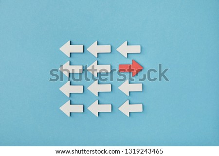 top view of white arrows with opposite red pointer on blue background #1319243465