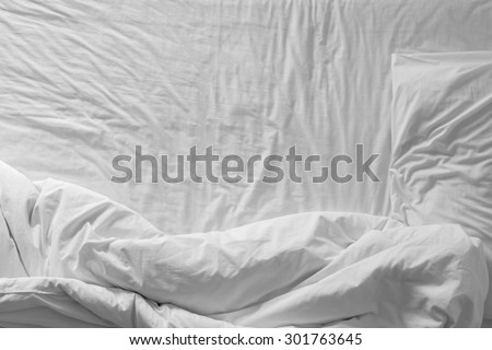 Top view of white bedding and pillow at morning time
