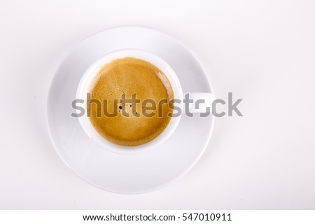 Shutterstock top view of white cup full with delicious coffee with crema
