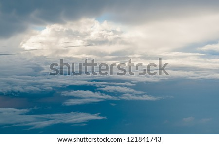 top view of white fluffy clouds from airplane