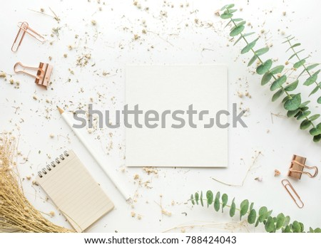 Top view of white paper on worktable with mock up accessories and dry flower.flat lay design/copy space #788424043