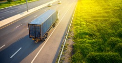 Top view of White Truck motion blur on highway road with blue container, transportation concept.,import,export logistic industrial Transporting Land transport on the expressway.soft focus