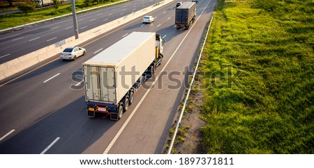 Top view of White Truck motion blur on highway road with container, transportation concept.,import,export logistic industrial Transporting Land transport on the expressway.soft focus