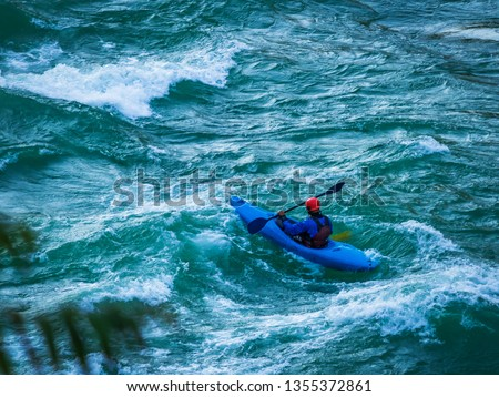 top view of Whitewater kayaking, extreme kayaking. A guy in a kayak sails on a mountain river Ganges in Rishikesh,  India