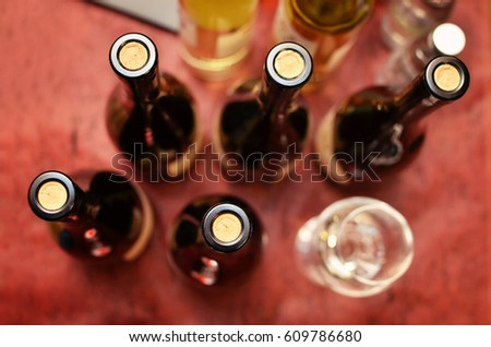 Top view of wine bottles with corkscrew and glass on the table #609786680