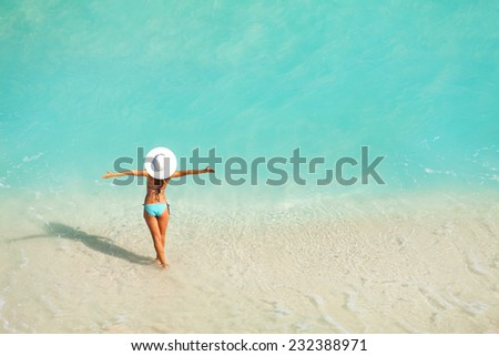 Top view of woman with white hat standing in ocean #232388971