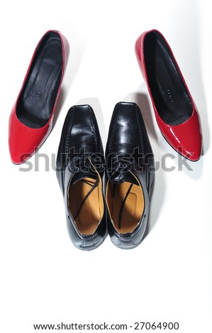 Top view of women and man shoes in conceptual sexual position