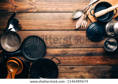 Top view of wooden rustic table with various kitchen utensils