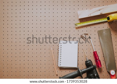 Top view of woodworking tools and notebook on a pegboard and blank copy space Stock photo ©