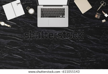 Top view of working space on black marble