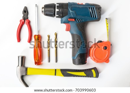 Top view of Working tools,wrench,socket wrench,hammer,screwdriver,plier,electric drill,tape measure,machinist square on white background. flat lay design.