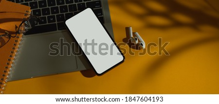 Top view of workspace with laptop, smartphone, earphone and copy space, include clipping path Сток-фото ©