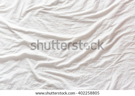 white bed sheet texture. Top View Of Wrinkles On An Unmade / Untidy White Bed Sheet In A Bedroom After Texture
