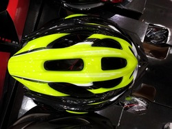 Top View of Yellow Black Sport Bicycle Helmet for Accident Protection. Flat Lay of Aerodynamic Mountain Bike Helmet use for Sport, Hobby and Work Activity