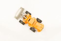 top view of yellow wheel loader isolated on white background,toy