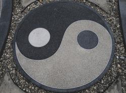 Top view of yinyang symbol on walkway.