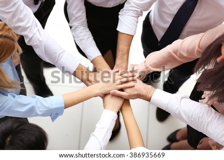 Top view of young people putting hands together #386935669