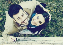 Top view of young smiling couple