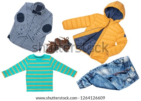 fe25a37424ca6 Top view on child boy set of clothes. Collage of apparel clothing. Jeans ,