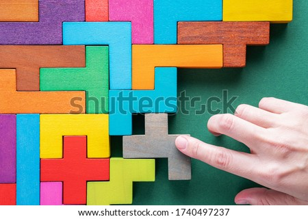 Top view on colorful wooden blocks. Concept of decision making process, logical thinking. Logical tasks Сток-фото ©