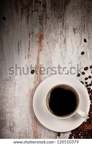 top view on cup of coffee over grunge wooden bacgkround