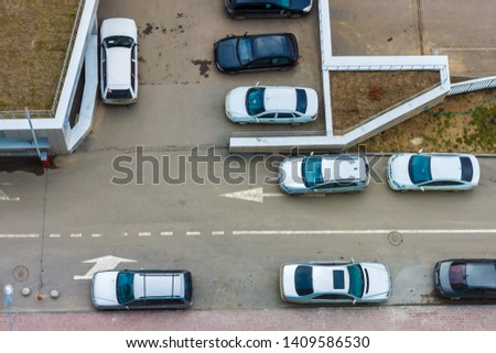 Top view on driveways in the residential area with many parked cars. Lack of parking places in the city problem concept. #1409586530