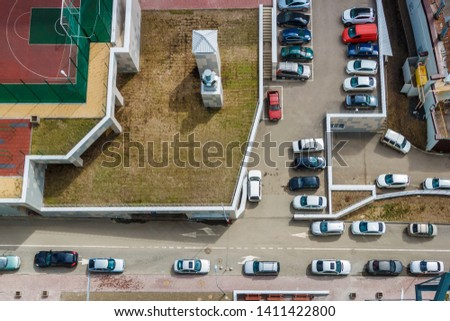 Top view on driveways in the residential area with many parked cars. Lack of parking places in the city problem concept. #1411422800