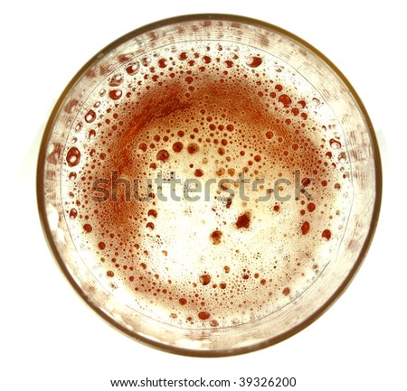 Top view on glass of beer on white background