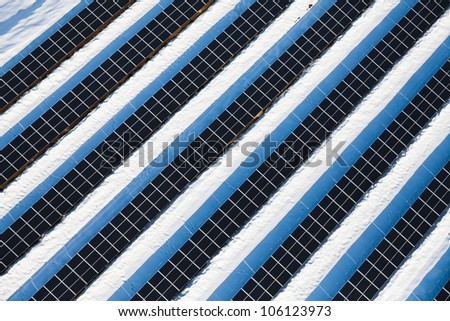 Top view on large solar panels in photovoltaic park