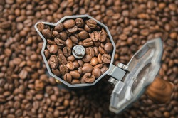 Top view on mocha pot full with coffee beans. Coffee background concept.