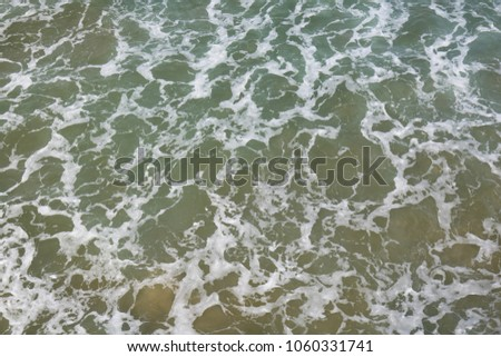 top view on moving sea water with waves and foam, texture background pattern #1060331741