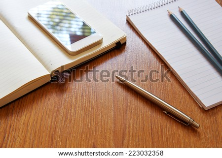 Top view on office workplace with pen in the middle