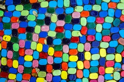 Top view on pieces of multicolored ceramic tiles decorated in garden. Old pavement of tiles textured. Street mosaic cobblestone sidewalk. Abstract,background and pattern of ceramic tile on the floor.